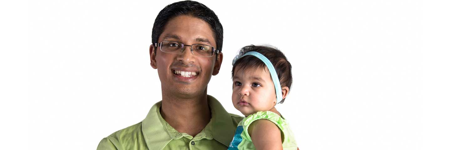 Father holds infant daughter.